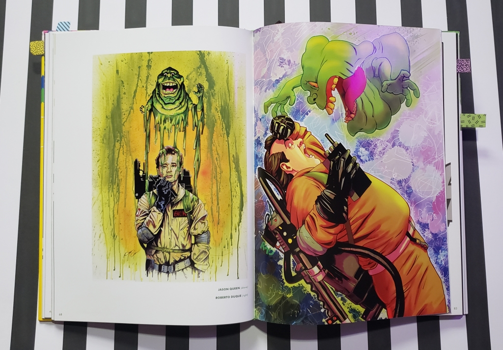 Ghostbusters artbook open on a black and white stripe background. pages are open to illustrations of a Slimer attack