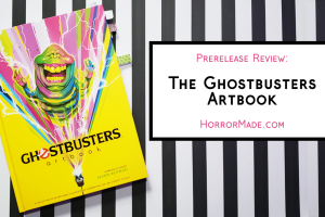 """Ghostbusters artbook on a black and white striped background with """"Prerelease review: the Ghostbusters Artbook. HorrorMade.com"""""""